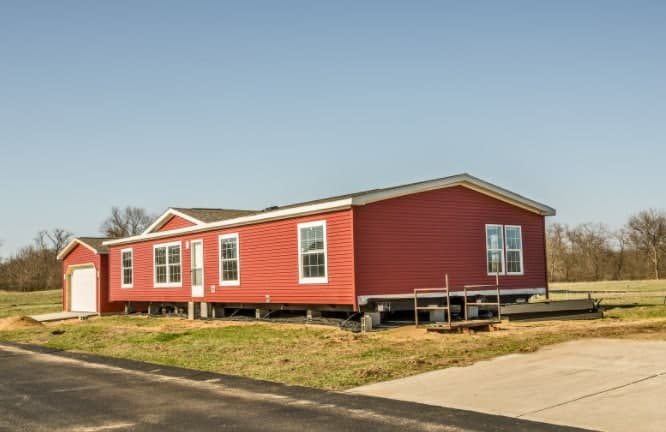 A mobile home on its new site